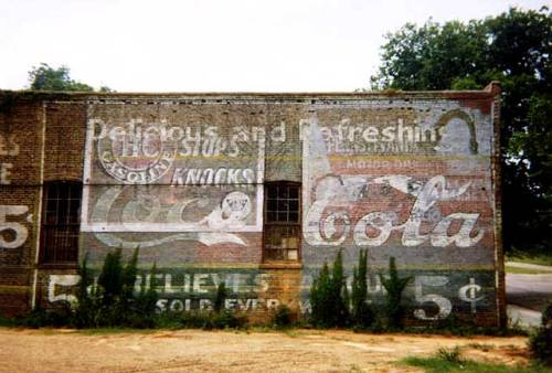 William Christenberry Wall of Building with Five Cent Stamps 1976