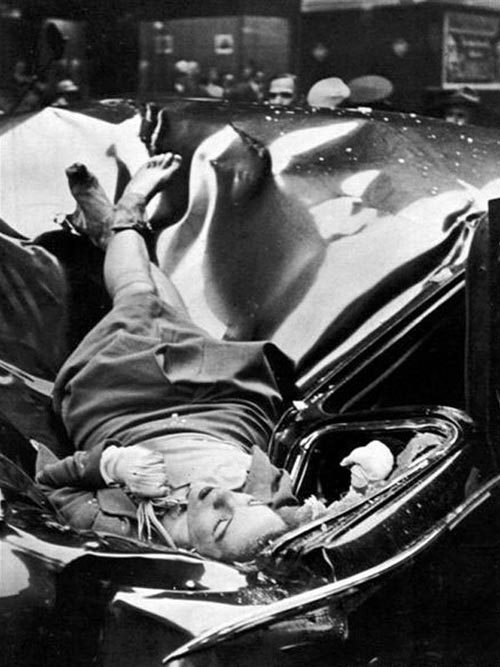 The most beautiful suicide On May 1, 1947, Evelyn McHale leapt to her death from the observation deck of the Empire State Building. Photographer Robert Wiles took a photo of McHale a few minutes after her death.  The photo ran a couple of weeks later in Life magazine accompanied by the following caption:  On May Day, just after leaving her fiancé, 23-year-old Evelyn McHale wrote a note. 'He is much better off without me … I wouldn't make a good wife for anybody,' … Then she crossed it out. She went to the observation platform of the Empire State Building. Through the mist she gazed at the street, 86 floors below. Then she jumped. In her desperate determination she leaped clear of the setbacks and hit a United Nations limousine parked at the curb. Across the street photography student Robert Wiles heard an explosive crash. Just four minutes after Evelyn McHale's death Wiles got this picture of death's violence and its composure. via