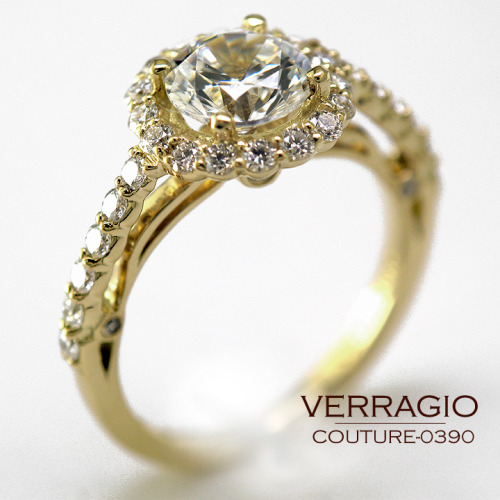 COUTURE-0390 engagement ring from the Couture Collection, featuring 0.45Ct. of shared-prong set round brilliant diamonds to enhance a round diamond center.Available in Palladium, 18K Gold and Platinum. Pictured here in 18K Yellow Gold.