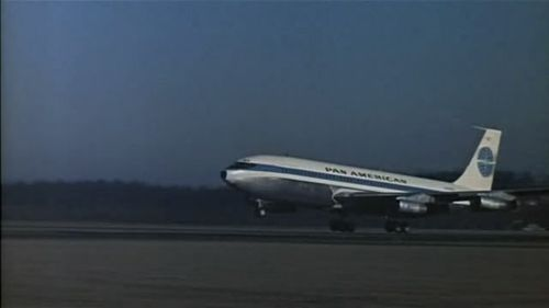 """Hello, New York. Your Pan-Am 323 just landed - Kingston,  Jamaica.""  from Movie Transcriptions Database  James Bond  flies a Pan Am Boeing 707 to Kingston, Jamaica  from Pan Am Movies @ everythingPanAm.com  The airline appeared in other movies, notably in several James  Bond films. The company's Boeing  707s were featured in Dr. No, From Russia with Love, while a Pan Am 747 and the Worldport appeared in Live and Let Die.  from Pan American World Airways @ findtarget.com  After a little banter with Miss Moneypenny, Bond begins a long tradition by swanning off to the West Indies. He is met by the impostor 'Mr Jones' at  Norman Manley International Airport, halfway  along the Palisadoes, the ten-mile spit which  protects the harbour at Kingston. Once Jamaica's  main international airport, it now mainly handles domestic flights.  from The  Worldwide Guides to Movie Locations"