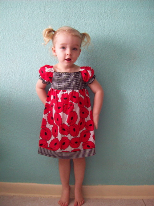 Amelia in her new red poppy dress.