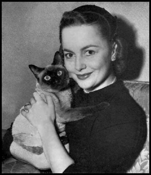 "Birthday girl and her Siamese, Cathy, named after Catherine Sloper, from ""The Heiress"""
