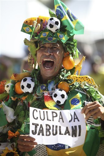 "dailyme:  A fan of Brazil's soccer team shouts as he holds a banner that reads ""It's Jabulani's fault"", in reference to the official 2010 World Cup soccer ball, after the quarter final soccer match between Brazil and Netherlands, at the Copacabana beach, in Rio de Janeiro, Friday, July 2, 2010. Netherlands beat Brazil 2-1. (AP Photo/Silvia Izquierdo)"