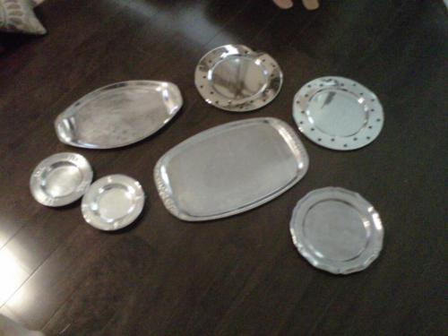 Bought a ton of silver trays and ready to paint them with chalkboard paint. Those two little nuggets on the left will be used for a nursery.