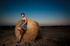 "The Hay Girl:   Photo from my recent photoshoot. This time we went in Larnaca near the salt lake. Chelsea was great and we did a couple of themes. This was one of my favorites. I've been wanting to try the hay bale shot for a while now - here it is :P Strobist info: YN460 at 1/2 power on a passthru umbrella camera left. Also a 43"" silver reflector on the opposite site helped a bit (:facebook - twitter @marios Please don't post any 'awards'. I can live without them. Instead say something nice!"