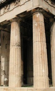 Doric Columns, the Hephaestieon It is believed that this style of column is older than Ionic or Corinthian columns.   The columns have no base, but stand directly on the foundation of the  building or temple.  Their vertical shafts are fluted and have a  standard number of 20 flutes per column.  the shaft also is wider at the  bottom than it is at the top connecting to the capital.  The top of the  column has a round capital that is topped by a square block.