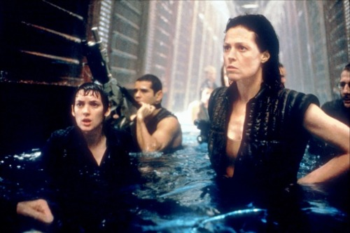 aliensandpredators:  Annalee (Winona Ryder), Distephano (Raymond Cruz), and Ripley (Sigourney Weaver), Alien: Resurrection, 1997 via toutlecine.com  The underwater sequence marked the first time that Winona Ryder had gone underwater since a near-drowning incident that happened to her when she was 12 years old. The actress suffered a complete anxiety attack on the first day of filming in the underwater set.  imdb