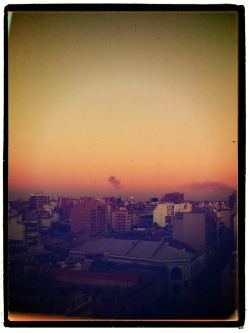 A fire on the horizon at sunset over Buenos Aires.