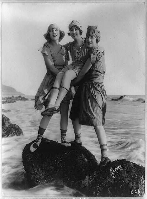 billyjane:  Myrtle Reeves, Lillian Langston, and Edith Roberts posed on rock in water for Mack Sennett Productions,c.1918