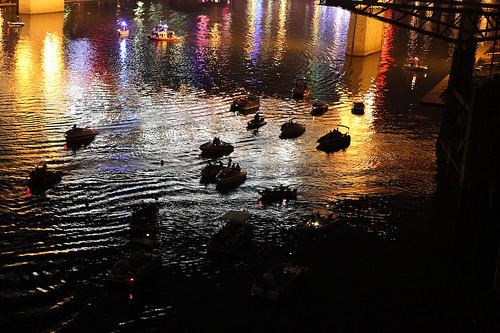gentusophotography:  Duckies on a Pond…but they're not really that at all! No, they're boats on the Cumberland River between the pedestrian bridge (the Shelby Street Bridge) and the Gateway Bridge (Korean War Veterans Memorial Bridge), all huddled together underneath the gorgeous glowing night sky as Nashville's fireworks dazzle the masses….