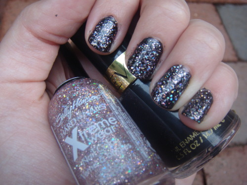 fashion-addict:  My nails a few weeks ago. I forgot that I had taken the picture so I hadn't put it up until now. Sorry that the edges are a bit sloppy. I hadn't cleaned them until after the picture. The colors are Revlon in Black Lingerie and Sally Hansen Xtreme Wear in Strobe Light.