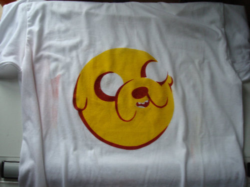 adventuretime:  I made this stenciled t-shirt for my boyfriend's birthday! It's just two stencils, and red and yellow spray paint. Jake is by far our favorite characters and he deserves to be immortalized in t-shirt form. submitted by Roxie Vizcarra