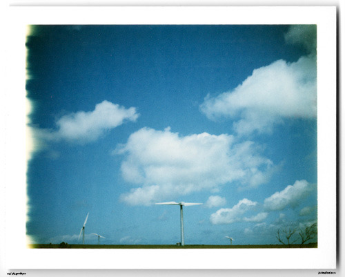Day 173. Wind Farming A395, Cornwall, UK.   Polaroid Land Camera 240 and 125i film (expired 12/2007).   Polaroid photograph, all rights reserved, copyright: Jo Bradford 2010