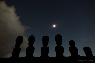 Easter Island Eclipse   Credit & Copyright:  Stéphane Guisard (Los Cielos de America), TWAN  Explanation:  Makemake, a god in Easter Island mythology, may have smiled for a moment as clouds parted long enough to reveal this glimpse of July  11's total solar eclipse to skygazers.  In the foreground of the  dramatic scene, the island's famous large, monolithic statues  (Moai) share a beachside view of the shimmering solar corona and the darkened daytime sky.  Other opportunities to see the total phase of this eclipse of the Sun were also hard to come by.  Defined by the dark part of the Moon's shadow,  the path  of totality tracked eastward across the southern Pacific Ocean, only making significant landfall at Mangaia (Cook Islands) and Easter  Island (Isla de Pascua), ending shortly after reaching southern Chile and Argentina.   But a partial eclipse phase could be enjoyed over a broader region, including  many southern Pacific islands and wide swath of South America.
