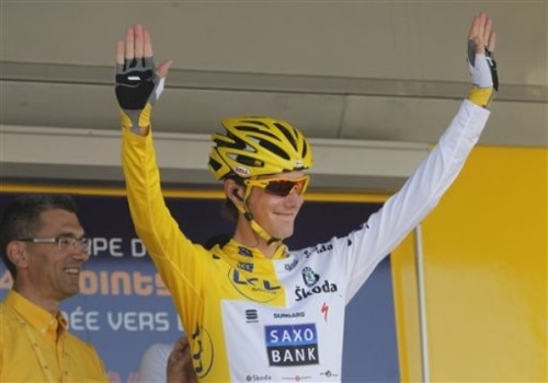 Andy Schleck of Luxembourg wears a combination of the overall leader's yellow jersey and the best young rider's white jersey, prior to the start of the 12th stage of the Tour de France cycling race over 210.5 kilometers (130.8 miles) with start in Bourg-de-Peage, and finish in Mende, France, Friday, July 16, 2010  (AP Photo via Daylife)