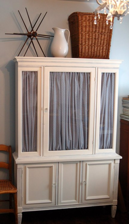 Excellent cabinet example. I'd do a different fabric….gray = blah.