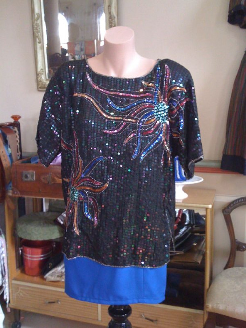 Sequin top covered front and back. SOLD
