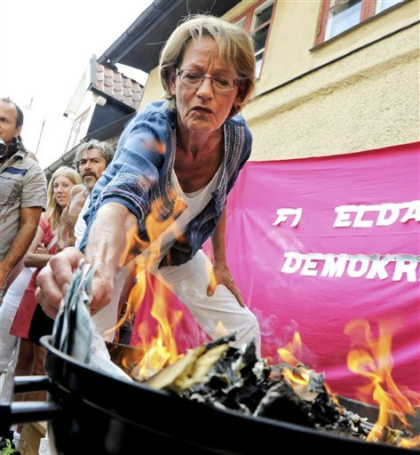 "marcea:  adailyriot:  humantype2:  AP:  Gudrun Schyman, party leader for the Swedish feminist party Feminist Initiative sets a wad of money ablaze in a protest against unequal pay for men and women in Visby, Sweden, on July 6, 2010. Some 100,000 Swedish kronor (EUR 10,000, USD 13,000), representing the amount Swedish women miss out every minute in comparison to men, were committed to the flames during the protest. (AP Photo/Janerik Henriksson)   I have a hard time believing this stuff to be actual problems in Sweden, Scandinavia and the likes, mostly because I've lived there (although I do not claim to know all things Swedish or Scandinavian, I'm just sharing my observations) and seen how focused the government is on equality for all people, foreigners, blacks, whites, males, females. They make more then enough money, as the leading countries of the world for overall highest living standard. And actually, apparently ""According to a new report, Sweden tops out as the #1 place for women to live."" Isn't it funny how we're never happy, or content? Just my 2 cents.  I could not agree more with this… Most of you have heard me rant about these things before, so I won't repeat it. Also, it's not like women and men with the same jobs don't earn the same things (usually, and if that is the case it's in order to recruit more men - such as to nurseries etc, often as a step towards BOOSTING THE OVERALL SALARY IN THAT PROFESSION) but rather the case is that typical professions for women, often in the state sector - teachers, nurses etc - are not as well paid as what private companies can offer - again since the state is paying. Oh the hypocrisy."