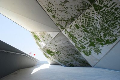 Green City - an art installation for the UK Pavilion at the 2010 World Expo in Shanghai. Green City maps the four UK capitals by displaying only the green spaces (botanical gardens, parks, roof gardens, etc) in astroturf.  via Troika