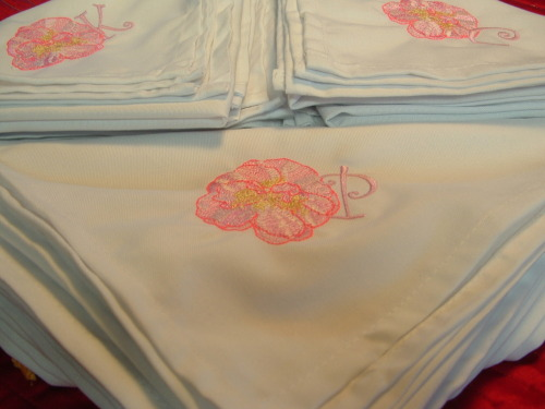We embroidered three sets of four napkins with the camellia.  All of the beautiful pinks in those camellias are stunning.  They turned out beautiful.  We have also been working on leopard font and prints and some scarves.  It's been a busy weekend.  We have to place some order this week and we're still waiting on the finger towels to arrive.  In the meantime, I'm working on scarves that I may list on Etsy.  Speaking of Etsy, the Hookers napkins and the Princess diaper bag were listed on Etsy and then purchased.  I have to get those napkins in the mail tomorrow.