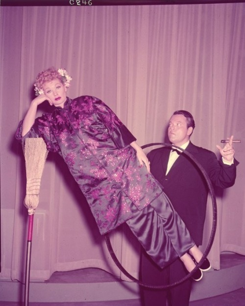"Orson Welles performs the ""Broomstick Suspension"" magic trick with Lucille Ball (1956, photo taken during the filming of the I Love Lucy episode, ""Lucy Meets Orson Welles"") (scene online here) ""I've never had a friend in my life who wanted to see a magic trick, you know. I don't know anybody who wants to see a magic trick. So I do it professionally; it's the only way I get to perform. I went once to a birthday party for [MGM boss] Louis B. Mayer with a rabbit in my pocket which I was going to take out of his hat. On came Judy Garland and Danny Kaye and Danny Thomas and everybody you ever heard of and then Al Jolson sang for two hours and my rabbit was peeing all over me, you know. And the dawn was starting to rise over the Hillcrest Country Club as we said goodnight to Louis B. Mayer and nobody'd asked me to do a magic trick. So the rabbit and I went home."" -Orson Welles, in 1982 documentary The Orson Welles Story"