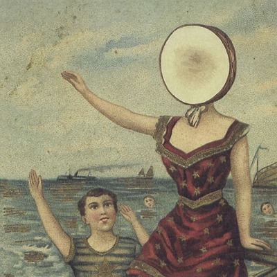 "Album of the Week: In the Aeroplane Over the Sea - Neutral Milk Hotel Truly one of the most incredible albums I have ever listened to, Neutral Milk Hotel's ""In the Aeroplane Over the Sea"" is something of pure brilliance. Fronted by Jeff Magnum, NMH was a band that became no more at a time which hurt music lovers around the world. While On Avery Island was a good album at best, their sophomore album is one that has been critically acclaimed, as well as refereed to as one of the best albums of the 90's (competing with albums such as Radiohead's ""OK Computer"", ""The Soft Bulletin"" from The Flaming Lips, ""Nevermind"" from Nirvana, and multiple albums from Pavement, who is one of the greatest bands of that decade). With tracks from ""Oh Comely"", ""Two-Headed Boy"" and the fantastic title-track, this album goes far beyond simple singles, and radio friendly tunes. Magnum and company created a raw, passionate sound with these eleven tracks. The beauty in the recordings is that something that is missing in all music you hear today. From those small imperfections, to that random accordion that comes in when you'd least expect it. The lo-fi sound and the emotive vocals/lyrics combine, giving this album the unity that has given it a reputation of one of the best albums ever written. Right now, go through your iTunes and find five albums that you cannot go without. You're going to find four easily. Then you're going to try and decided between a couple for that last spot. Do yourself a favor, and choose ""In the Aeroplane…"", you won't regret it.  If you have ever considered yourself a fan of music, and you have either never heard, or don't own this album, do yourself and your ears a favor, and get it right now. iTunes."