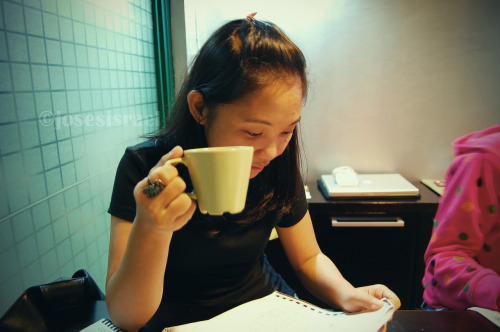 A photo of whendarknessfell at work. She almost always has a cup of coffee attached to her hand. :D