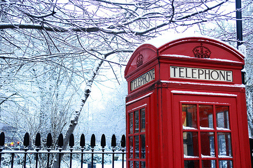 Traditional London phone box in the snow.