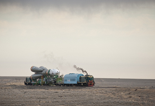 Expedition 23 Soyuz Rollout (201003310007HQ) (by nasa hq photo) The Soyuz TMA-18 spacecraft is rolled out by train to the launch pad at  the Baikonur Cosmodrome, Kazakhstan, Wednesday, March, 31, 2010. The  launch of the Soyuz spacecraft with Expedition 23 Soyuz Commander  Alexander Skvortsov of Russia, Flight Engineer Mikhail Kornienko of  Russia, and NASA Flight Engineer Tracy Caldwell Dyson is scheduled for  Friday, April 2, 2010 at 10:04 a.m. Kazakhstan time. Photo Credit  (NASA/Bill Ingalls)