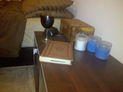 Wine, book, evening candles. In for the night.
