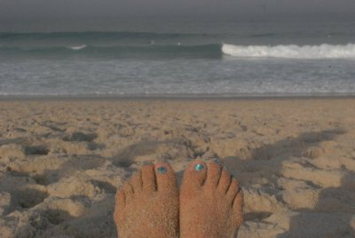 Bright Blue Toenails at Nauset Beach in Cape Cod, MA. Summer 2010. I like feet.  Not in a weird foot fetish kind of way, but in a way that feet are cool because they  get you from point A to point B and the points in between.  In a way that these feet let me dance and move in a way which makes me feel joyful and alive.  Feet are pretty cool I think.  This photo series, Feet First by Tom Robinson, of feet across the globe are innovative and fun.  They give a fantastic sense of place and tell a lot about the photographer and his friend as well as where in the world they are.  Someday, I'd like to visit these places.  I'd like to walk around the world in step with someone else, going from here, to there, and everywhere in between.
