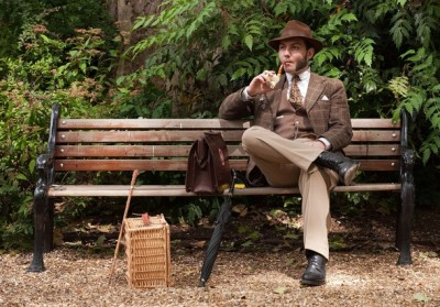 "The 6th Annual Chap Olympiad 2010 - ""A man smokes his traditional pipe at the 'The Chap's Olympiad' in central London  on July 17, 2010.'The Chap' is a light-hearted magazine, aimed at revisiting the fashions and pastimes of the polite aspects of 1920's to 1950's England. The annual Olympiad event sees competitors take part in events such the 'Cucumber Sandwich Discus', 'The Umbrella Joust' and 'The Tug of Hair'"". (Submitted by: @SFranciscoTweet)"