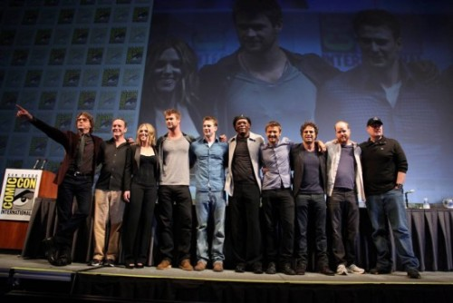 OMG SO AWESOME. thedailywhat:  SDCC Photo of the Day: The entire cast of Joss Whedon's just-assembled Avengers on a single stage at Comic-Con. L to R: Robert Downey Jr. (Iron Man); Clark Gregg (SHIELD Agent Coulson); Scarlett Johansson (Black Widow); Chris Hemsworth (Thor); Chris Evans (Captain America); Samuel L. Jackson (Nick Fury); Jeremy Renner (Hawkeye); Mark Ruffalo (The Hulk); Joss Whedon; and Marvel Studios' President Kevin Feige. [/film.] Also: Some dude in a Harry Potter tee stabbed another dude over a chair in SDCC's notorious Hall H? Damn nerds, you scary.