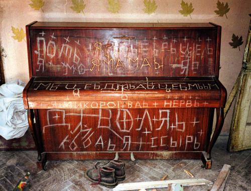 The Piano. Lenin Mitasov suffered from a  psychiatric condition that led him to cover all surfaces in his  apartment with inscriptions, often in several layers. photo: Pavel Makov.Found here.