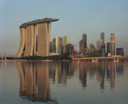 Marina Bay Sands Hotel in Singapore (via gizmodo's awesome gallery of architecture utilizing nature), with over 100,000 sq. ft of park on top of three towers.