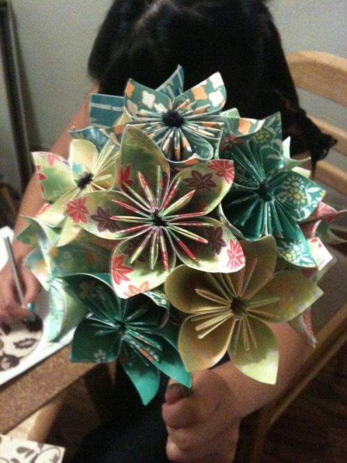 fuckyeahwedding:  fuckyeahorigami:  samsikle:  Bouquet origami flowers for Liz' wedding. The bridesmaids have made so many that we won't do anymore origami for the rest of our lives.