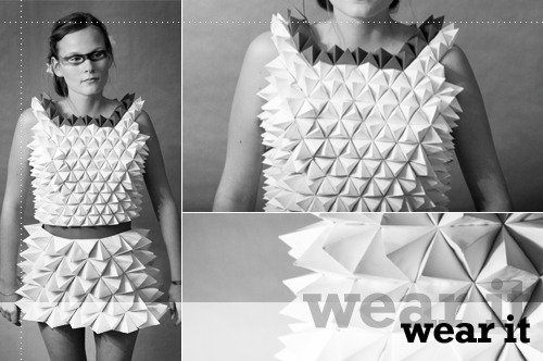Now here's an exquisite dress constructed out of paper. I can't help but wonder how (or if for that matter) comfortable this dress is when worn. I can't even begin to imagine sitting down in that dress, but I'm sure it involves some evasive maneuvers.