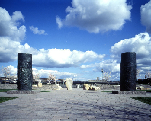 "Japanese American Historical Plaza ""Using thirteen engraved stones of basalt and granite, the Japanese  American Historical Plaza in Portland tells an important story of the  Japanese in Oregon. Landscape architect Robert Murase created the theme  and design of the plaza to tell the story of the hardships suffered by  Japanese immigrants and the indignities imposed by the incarceration of  persons of Japanese ancestry during World War II. The plaza shows how  the rights of Japanese Americans on the West Coast were denied, and  honors the bravery of those who served in the U.S. Armed Forces while  their families were in the camps. The story continues with poems inscribed on stones. The stone at the  center of the plaza lists the ten internment camps. The base of this  stone is surrounded by flagstones with jagged sides laid out in  irregular patterns reflecting the broken dreams of the internees. Poets Lawson Inada (Ashland),  Shizue Iwatsuki (Hood River, deceased), Masaki Kinoshita (Portland,  deceased), and Hisako Saito (Portland, deceased) composed the inscribed  poems. Murase was inspired to design the plaza while attending a Day of Remembrance memorial, which Japanese American communities hold throughout the  country to remember February 19, 1942, the day President Franklin D.  Roosevelt signed Executive Order 9066. The order was the first step that  led to the imprisonment of 120,000 persons of Japanese ancestry on the  West Coast. In March, 1942, the U.S. Army posted exclusion orders in  towns and cities on the West Coast, advising all persons of Japanese  ancestry to prepare to be evacuated from their homes and businesses.   The Historical Plaza, which presents poems of Japanese experiences,  is a permanent reminder of the importance of the U.S. Constitution and  the Bill of Rights. The last stone has a bronze plaque with excerpts  from the Civil Liberties Act of 1988, which includes an apology for the  unlawful imprisonment of people of Japanese ancestry during World War  II. "" According to a Portland news website, the Plaza ""bear[s] the great national legacy as the first  memorial to civil liberties."""