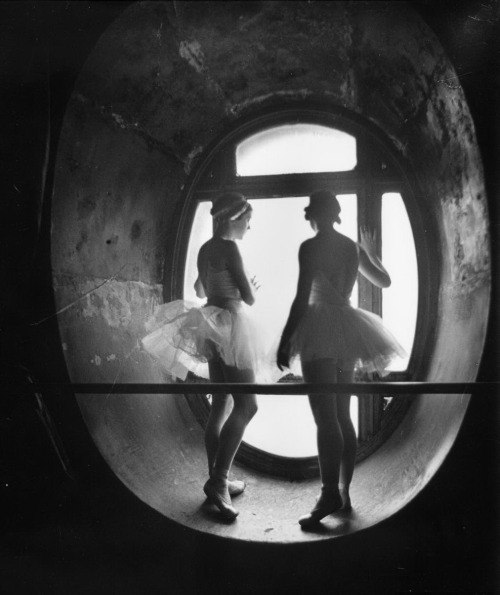 Ballerinas standing between barre and round windows against which they are silhouetted during rehearsal for Swan Lake at Grand Opera de Paris  by Alfred Eisenstaedt  from LIFE [few more here and at liquidnight;]