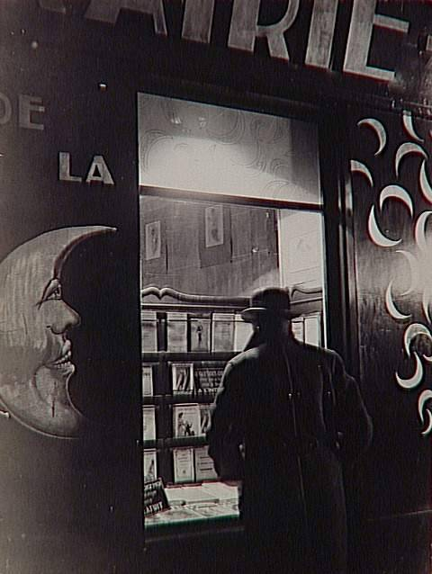 "crashinglybeautiful:  Brassaï, ""La Librairie de la Lune [The Library of the Moon],"" Paris, circa 1931-1934 (from lushlight & liquidnight: via the Réunion des Musées Nationaux)"