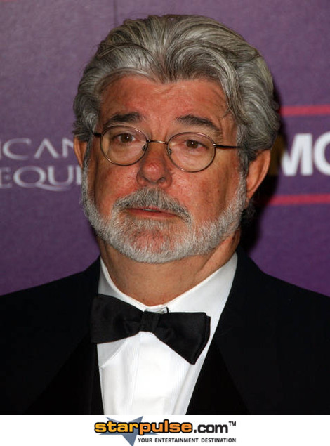 George Lucas suddenly realizes he forgot to put a bowtie on his neck as well.