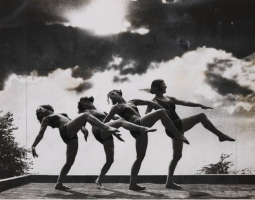 The Margaret Morris Dancers, 24 August 1932. Beauty of clouds and rhythm. A striking study taken of the Margaret Morris * dancers, practising a rhythm dance in the open air at the Margaret Morris Summer School at Matlock, Derbyshire, with the perfect background of the summer sky at sunset.