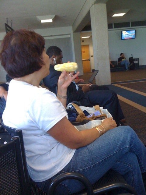 Sitting in Evansville airport, this woman sitting next to me randomly just pulls out an ear of corn from her purse.  I was amazed, and she was enjoying her corn.  Supposedly she pulled another one out of her purse in flight, per my co-worker. #cantmakethisup
