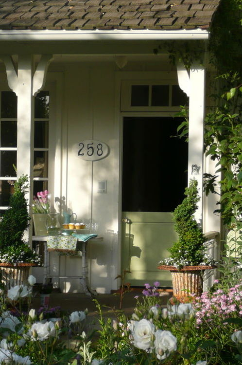 Love the dutch door! (from Velvet & Linen)