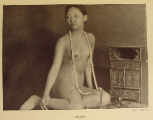 "Chinese woman, almost certainly a prostitute, and probably from an early-20th-century catalog of the ""races of man"".  This was a popular style—I have several examples—and provided Western scholars a good reason to take pictures of exotic naked women."