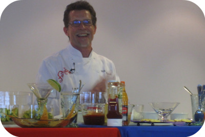 "emphasisadded:  Yup, this is Top Chef, Rick Bayless laughing with us about avocados and such! Chef Bayless came to new job yesterday for a cooking demo, question time & book signing.  He was totally and completely delightful as he talked to us about roof top gardens and the challenges facing boutique farmers. It was a really neat experience watching one of my culinary heroes talk candidly while whipping up guacamole, shrimp cocktail and ceviche for us to taste. Very cool day.  Very cool man. And as a treat for all my readers, I share with you one of the recipes he made from his new book, Fiesta at Rick's: Bacon and Tomato Guacamole 5 strips medium-thick bacon 3 medium-large ripe avocados 1/2 medium white onion, chopped into 1/4 inch pieces (WHITE onion…not yellow.  Chef was very specific about this!) 2 or 3 canned chipotle chiles en adobo to taste, removed from the canning sauce, stemmed slit open, seeds scraped out and finely chopped 1 medium-large round, ripe tomato cored and chopped into 1/4 inch piece 1/4 cup coarsely chopped fresh cilantro (thick bottom stems cut off), plus a little extra for garnish Salt 1-2 tablespoons fresh lime juice Cook and crumble bacon.  Mash the avocados in a bowl.  Rinse and strain onions, transfer to to the bowl along with the chipotle chiles, tomato, cilantro and about 2/3 of the bacon.  Gently Stir to combine all ingredients.  Season to taste and add just enough lime juice to ""add a little sparkle."" Que Bueno!  So much win in one post.  Bayless + guac + bacon = WIN!"