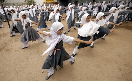 This is freakin cool. curate:  Muslim school girls from St. Maaz high school   practise Chinese wushu martial arts inside the school compound in  the southern Indian city of Hyderabad, July 8th 2008. Girls from ages  10-16 participate in weekly sessions during the school terms.  Muslim Schoolgirls and General Bad-Assery | KABOBfest