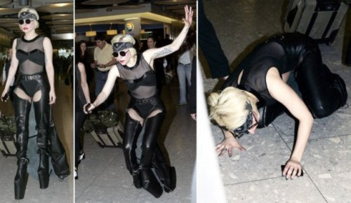 Lady Gaga Fall at Heathrow Airport We are experiencing technical difficulties. While we don't have a clip,  here's a photo of the incident at hand as Lady Gaga became fashion  roadkill today when she tripped over her gigantic platforms and fell on  her face at Heathrow Airport. Let's hope she can still rah-rah-rah after  this awful incident!