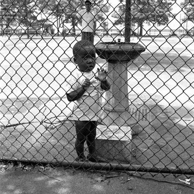 Child near water fountain [Vivian Maier - Her Discovered Work]