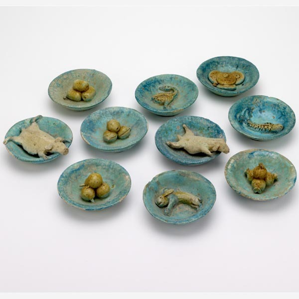 bolth:  Model Food Dishes For the Afterlife China Ming dynasty, about AD 1450–1600 These model food dishes present the ingredients for a feast for the soul in the afterlife and give us an idea of the types of food enjoyed by the living in China, in about AD 1450–1600. The foods are arranged as five main meats (a goat, a pig, a rabbit, a fish and a goose) and five accompanying dishes (pomegranates, peaches, water chestnuts, persimmons and mantou [steamed bread]). They are arranged in groups of four as the Chinese word 'si' meaning four has the same pronunciation as, but different tone from, the word 'si' meaning death.